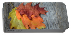 Autumn Leaves On Rustic Wooden Background Portable Battery Charger