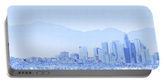 Buildings In A City With Snowcapped Portable Battery Charger