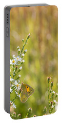Butterfly In A Field Of Flowers Portable Battery Charger