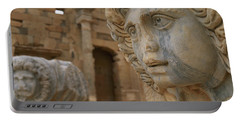 Close-up Of Statues In An Old Ruined Portable Battery Charger