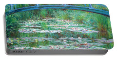 Portable Battery Charger featuring the photograph Monet's The Japanese Footbridge by Cora Wandel