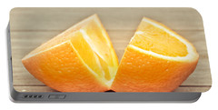 Orange Portable Battery Charger by Tom Gowanlock