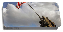 Portable Battery Charger featuring the photograph Raising The American Flag by Cora Wandel