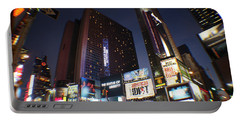 Portable Battery Charger featuring the photograph Times Square Nyc by Rogerio Mariani