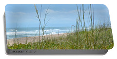 Portable Battery Charger featuring the photograph Archie Carr Beach And Wildlife Refuge by Carol  Bradley