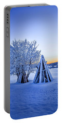Wood Stacked And A Snow Covered Tree Portable Battery Charger