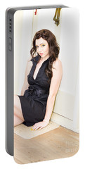 Young Woman Waiting By A House Door Portable Battery Charger