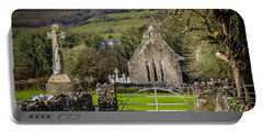 12th Century Cross And Church In Ireland Portable Battery Charger