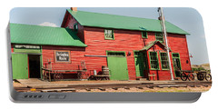 Portable Battery Charger featuring the photograph 1906 Depot by Sue Smith