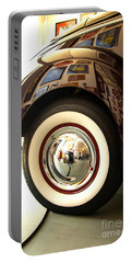 Portable Battery Charger featuring the photograph Classic Maroon 1940 Ford Rear Fender And Wheel   by Jerry Cowart
