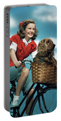 1940s 1950s Smiling Teen Girl Riding Portable Battery Charger