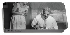 1950s Husband Eating Dinner As Wife Portable Battery Charger