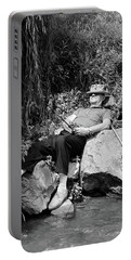 1950s Lazy Fisherman Lying Back On Rock Portable Battery Charger