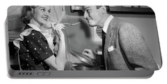 1950s Smiling Housewife At Stove Giving Portable Battery Charger
