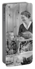 1950s Woman In Apron Putting Turkey Portable Battery Charger