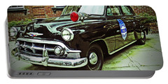 Portable Battery Charger featuring the photograph 1953 Police Car by Patricia Greer