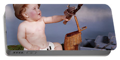 1960s Baby In Fisherman Hat Holding Portable Battery Charger