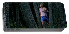 A Woman Trail Running In The Forests Portable Battery Charger