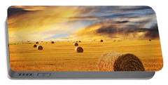 Golden Sunset Over Farm Field With Hay Bales Portable Battery Charger