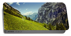 Portable Battery Charger featuring the photograph Lauterbrunnen Valley In Bloom by Jeff Goulden