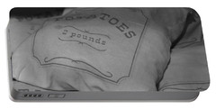 2 Pounds Of Potatoes Portable Battery Charger by Holly Blunkall