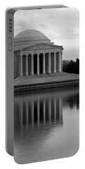 Portable Battery Charger featuring the photograph The Jefferson Memorial by Cora Wandel