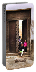 Portable Battery Charger featuring the photograph Kids Playing Zanzibar Unguja Doorway by Amyn Nasser
