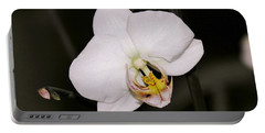 Portable Battery Charger featuring the photograph White Orchid by Sherman Perry