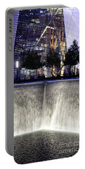 Portable Battery Charger featuring the photograph World Trade Center Museum by Lilliana Mendez