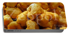 Portable Battery Charger featuring the photograph Zeppoli by Lilliana Mendez