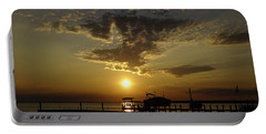 An Outer Banks Of North Carolina Sunset Portable Battery Charger by Richard Rosenshein