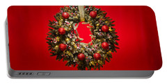Advent Wreath Over Red Background Portable Battery Charger