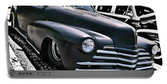 Portable Battery Charger featuring the photograph '47 Chevy Lowrider by Victor Montgomery
