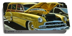 Portable Battery Charger featuring the photograph '52 Chevy Wagon by Victor Montgomery