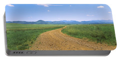 Dirt Road Passing Through A Landscape Portable Battery Charger