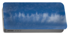 Portable Battery Charger featuring the photograph A Batch Of Interesting Clouds In A Blue Sky by Eti Reid