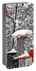A Cardinal Winter Portable Battery Charger by Lydia Holly