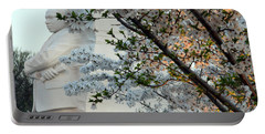 Portable Battery Charger featuring the photograph A Cherry Blossomed Martin Luther King by Cora Wandel