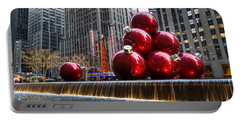 A Christmas Card From New York City - Radio City Music Hall And The Giant Red Balls Portable Battery Charger by Georgia Mizuleva