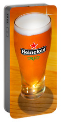 A Cold Refreshing Pint Of Heineken Lager Portable Battery Charger by Semmick Photo