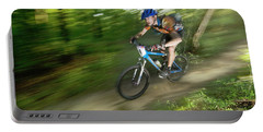 A Competitor Races Through The Woods Portable Battery Charger