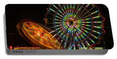 Portable Battery Charger featuring the photograph Colorful Carnival Ferris Wheel Ride At Night by Jerry Cowart