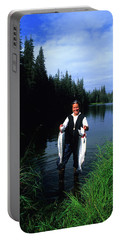 A Female Angler Holds Two Silver Coho Portable Battery Charger