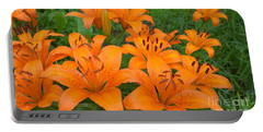A Garden Full Of Lilies Portable Battery Charger