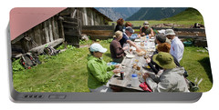 A Group Of Hikers Eat Tofu For Lunch Portable Battery Charger