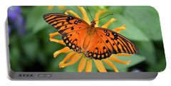 A Gulf Fritillary Butterfly On A Yellow Daisy Portable Battery Charger by Eva Kaufman