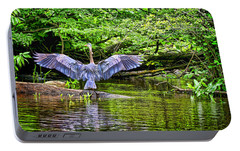 Portable Battery Charger featuring the photograph A Heron Touches Down by Eleanor Abramson