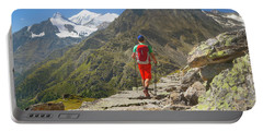 A Hiker Is Walking Over A Rocky Portable Battery Charger