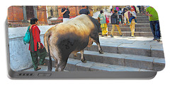 A Holy Cow Climbing Steps From Bagmati River In Kathmandu-nepal  Portable Battery Charger