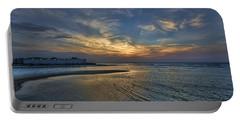 a joyful sunset at Tel Aviv port Portable Battery Charger